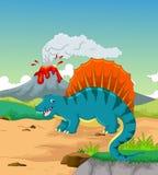 Cute dinosaur cartoon with volcano background Stock Photo