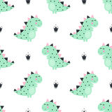 Cute dinosaur with crowns seamless pattern on white background. Royalty Free Stock Photos