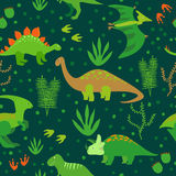 Cute dinosaurs seamless pattern. Vector background with cartoon green dinosaurs on dark Stock Images