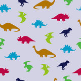 Cute dinosaurs seamless pattern. Vector background with dinosaurs silhouettes Royalty Free Stock Images