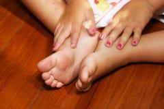 Cute dirty feet. Little girls feet and hands Royalty Free Stock Photos