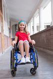 Cute disabled pupil smiling at camera in hall Stock Photography