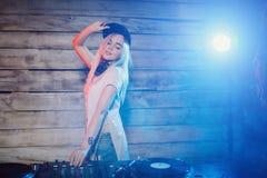 Cute dj woman having fun playing music at club party Stock Image