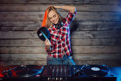Cute dj woman having fun playing music at club party. Cute dj woman having fun playing music on vinyl record deck at club party nightlife lifestyle Stock Image