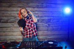 Cute dj woman having fun playing music at club party Stock Photo