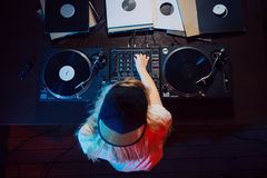 Cute dj woman having fun playing music at club party. Cute dj woman having fun playing music on vinyl record deck at club party nightlife lifestyle. Top view Royalty Free Stock Images