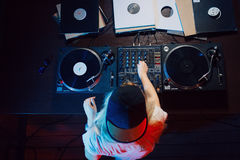 Cute dj woman having fun playing music at club party. Cute dj woman having fun playing music on vinyl record deck at club party nightlife lifestyle. Top view Stock Images