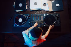 Cute dj woman having fun playing music at club party. Cute dj woman having fun playing music on vinyl record deck at club party nightlife lifestyle. Top view Royalty Free Stock Photo