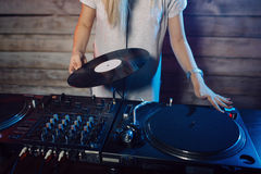Cute dj woman having fun playing music at club party Stock Photography