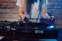 Cute dj woman having fun playing music at club party Royalty Free Stock Image