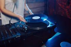 Cute dj woman having fun playing music at club party Royalty Free Stock Photo