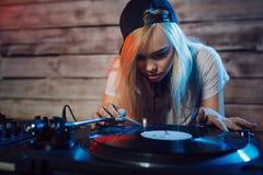 Cute dj woman having fun playing music at club party Stock Photos