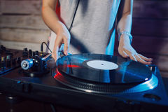 Cute dj woman having fun playing music at club party Royalty Free Stock Photography