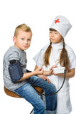 Cute doctor girl measuring blood pressure of a boy Royalty Free Stock Image