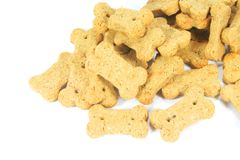 Cute Dog Snacks Shaped into a Bone Royalty Free Stock Image