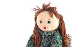 Cute Doll Looking into White Copy Space. A cloth handmade doll with red or brunette hair and blue eyes, wearing a green calico dress and looking into empty space Stock Images