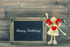Cute doll with Red Heart. Lovely Birthday decoration. Holidays c Stock Photo