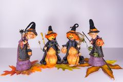 Cute Witches getting ready for Halloween Party stock photo