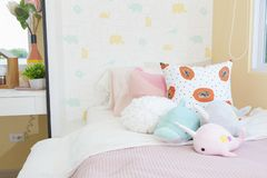 Cute dolls on bed for little girl royalty free stock photography