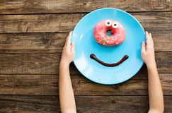 Cute donut on a breakfast Stock Images