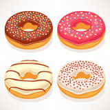 Cute donuts. Set of four cute donuts with colorful glaze Stock Images