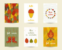 Cute doodle autumn cards. Brochures, invitations with acorn, camp fire, rubber boots, leaves frame. Cartoon objects, animals background. Printable templates Royalty Free Stock Photo