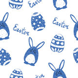 Cute doodle bunnies and eggs. Easter seamless. Pattern. Holiday background in blue and white vector illustration