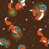Cute doodle fox-astronauts floating in space Royalty Free Stock Photo