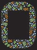 A doodle photo frame with leaves and rowan berries on a black background