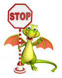 Cute Dragon cartoon character with stop sign. 3d rendered illustration of Dragon cartoon character with stop sign Royalty Free Stock Image