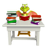 Cute Dragon cartoon character with table and chair and book stac Royalty Free Stock Photos