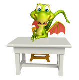 Cute Dragon cartoon character with table and chair Royalty Free Stock Images
