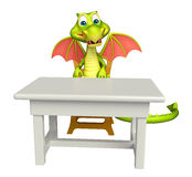 Cute Dragon cartoon character with table and chair Stock Photography