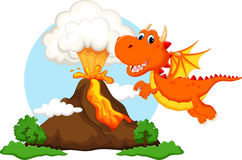 Cute dragon cartoon with volcano background Royalty Free Stock Photo