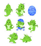Cute dragons. Green cartoon baby dragons on the white background Stock Photography