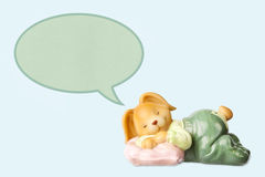 Cute dreaming baby rabbit toy Stock Images