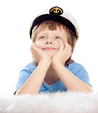 Cute dreaming child in captain cap Royalty Free Stock Photos