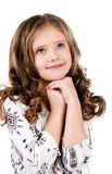 Cute dreaming little girl looking up Stock Photography