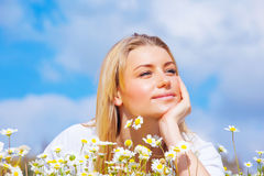 Pretty woman on daisy meadow Stock Images
