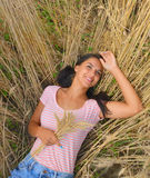 Cute dreamy girl on golden ripe wheat field Royalty Free Stock Images