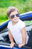 Cute driver in blue car Stock Photography