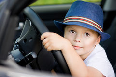 Cute driver in hat in car Stock Image