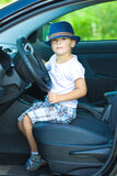 Cute driver in hat in car Stock Photo