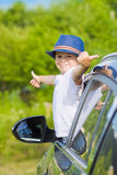 Cute driver in hat in car Royalty Free Stock Photo