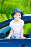 Cute driver in hat in car Royalty Free Stock Photos