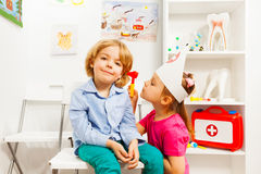Cute ear nose throat specialist examining boy Royalty Free Stock Photography