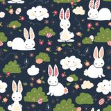 Cute Easter bunnies seamless vector kids pattern. Cute bunny, Easter eggs, flowers, clouds on blue background. Cartoon style royalty free illustration