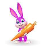 Cute Easter Bunny with big carrot Royalty Free Stock Photos