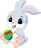 Cute Easter Bunny cartoon painting an egg Royalty Free Stock Photography
