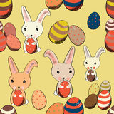 Cute Easter bunny with colored eggs in vintage style seamless pattern. Vector illustration on yellow background. Hand drawn cute Easter bunny with colored eggs royalty free illustration